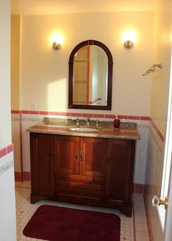 Private bath, beautiful granite-top  wash stand.