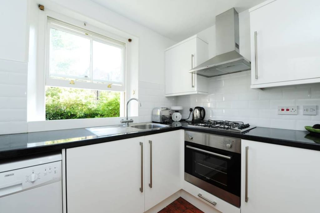 Kitchen with all mod cons; (oven, cooker, dishwasher, washing machine)