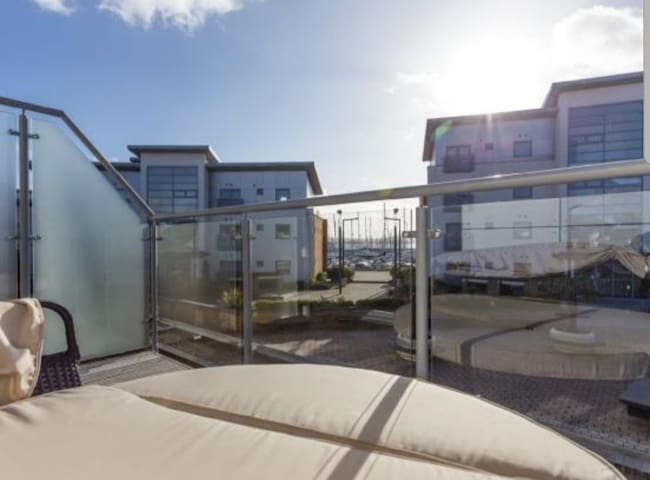 Top floor balcony with double day bed and electric heater.  Views of Poole inner harbour.