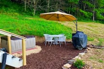 Hot tub patio with a charcoal and gas grill.  Charcoal and gas provided