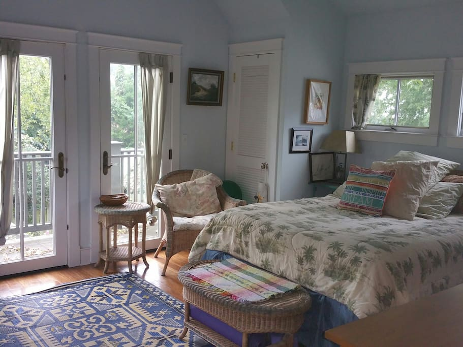 Guest Bedroom with Porch and Queen Sized Bed