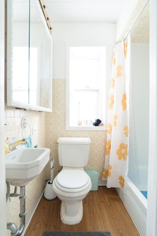 Small bathroom, but fully functional. Tub, shower and full vanity.