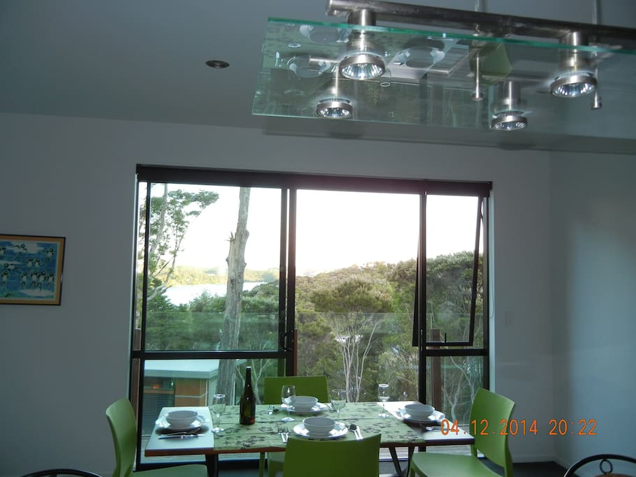 Dining area seats 6 with view over tree tops to sea.
