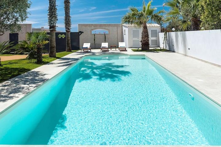 Moderne Wohnung in geräumiger Villa mit Pool und Garten