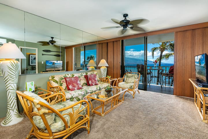 Living room with split AC, sofa bed, large flat screen TV, 5G Wi-Fi and ocean views.