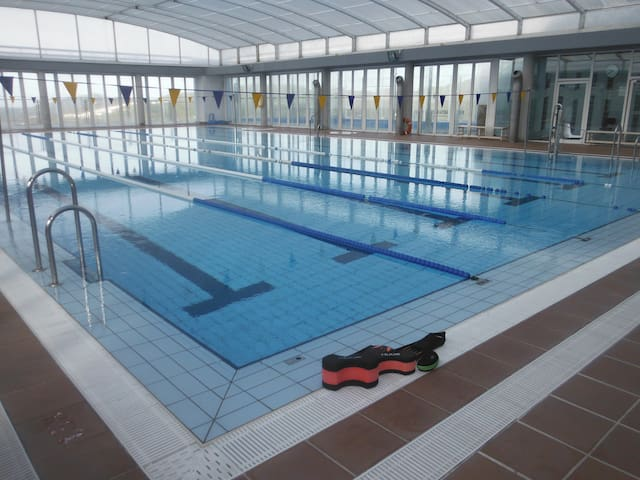 There is a 25m swimming pool in town, open all year. I'm a triathlon coach so let me know if you want a coached swim session.