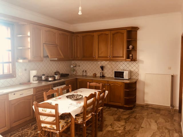 The kitchen of the house is fully equipped and spacious. There is a coffee machine, microwave, fridge, dishwasher and an oven.