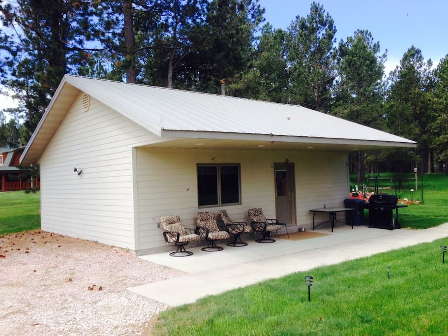 Cabin with covered patio.   Includes gas grill for your use