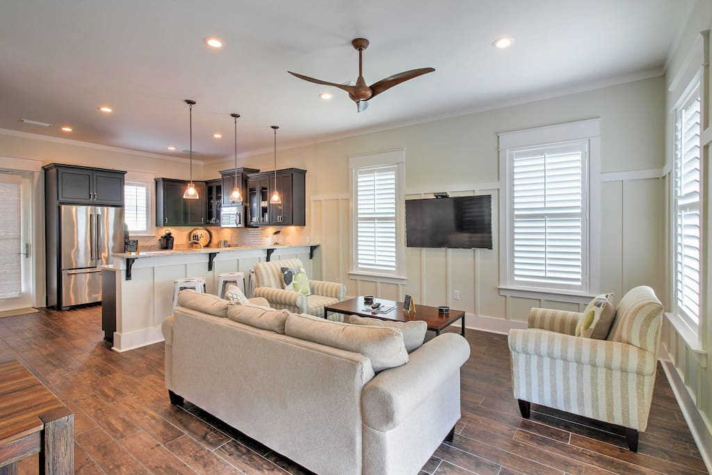 The newly built home welcomes you with wood floors, numerous windows and tasteful decor.