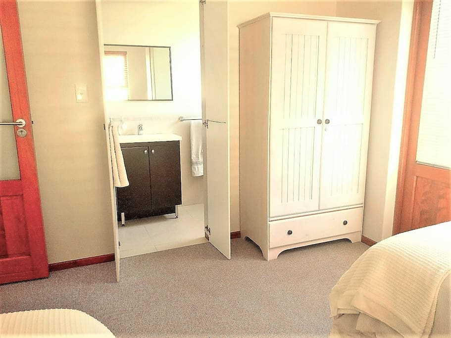 2nd bedroom with en-suite shower, basin and toilet