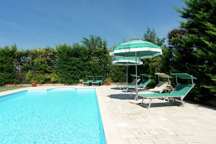 Centrally located holiday home with swimming pool and flowered garden