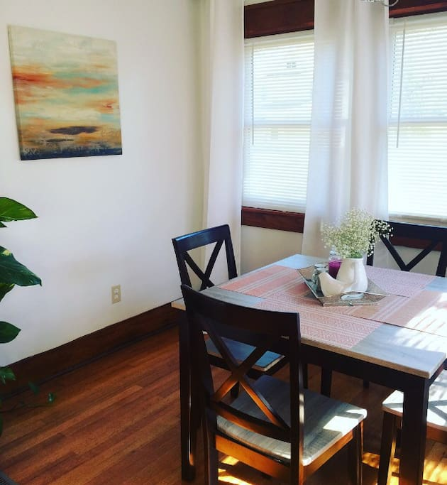 Sunroom/dining room with plenty of natural light to wake you up while you are enjoying your coffee in the morning.
