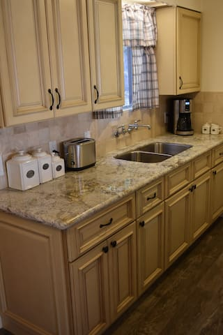 Newly remodeled galley-style  kitchen