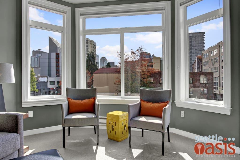 The large bay windows let in plenty of natural light.