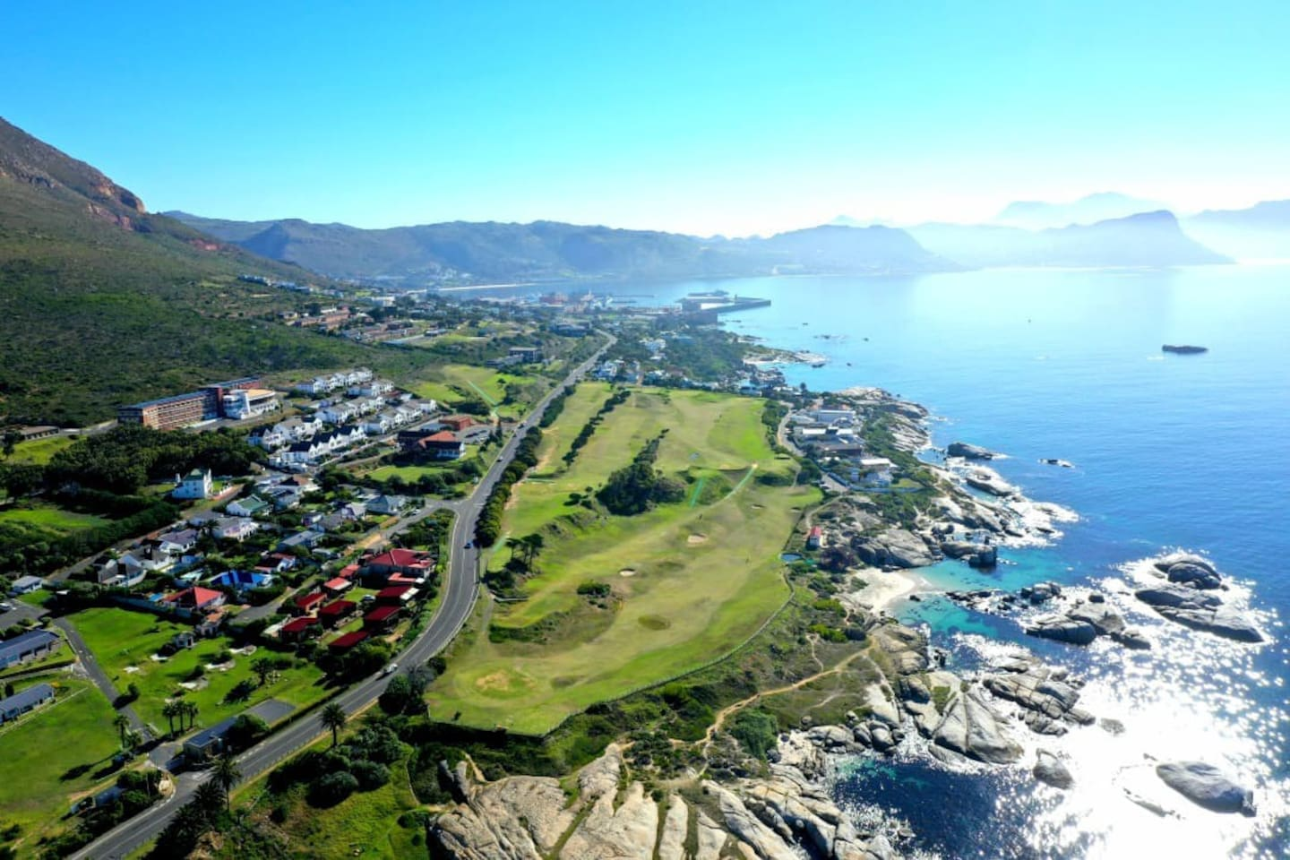Aerial view of location. Porcupine Walk is immediately behind the big red roof in the photo. The beautiful Simon's Town Golf Course is across the road and the Boulders Penguin Colony is a 5 minute walk away. Windmill Beach clearly visible.