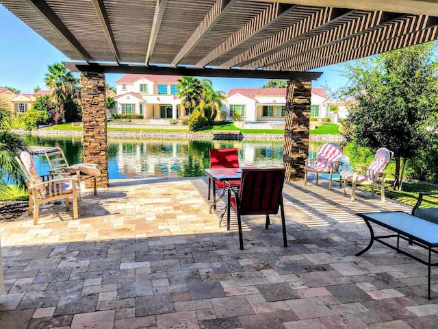 Large portico over back patio right on the water
