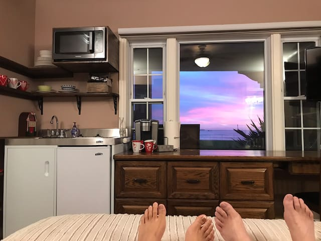 Kick back and enjoy spectacular views or watching the wide screen Smart TV from the comfort of your bed.
