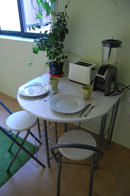 The foldable table is a perfect place to work on your laptop or to bring in your breakfast. The room comes with wi-fi.