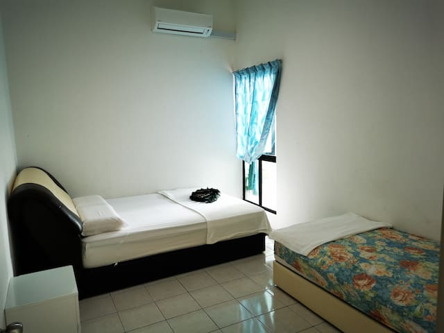 Room 2: One queen bed, one single bed with A/C
