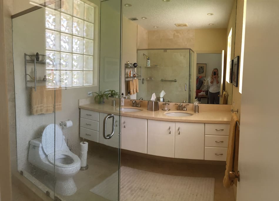 Master bath with marble and all glass enclosure shower.