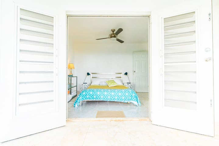 Master bedroom. Light and airy with a gorgeous view.