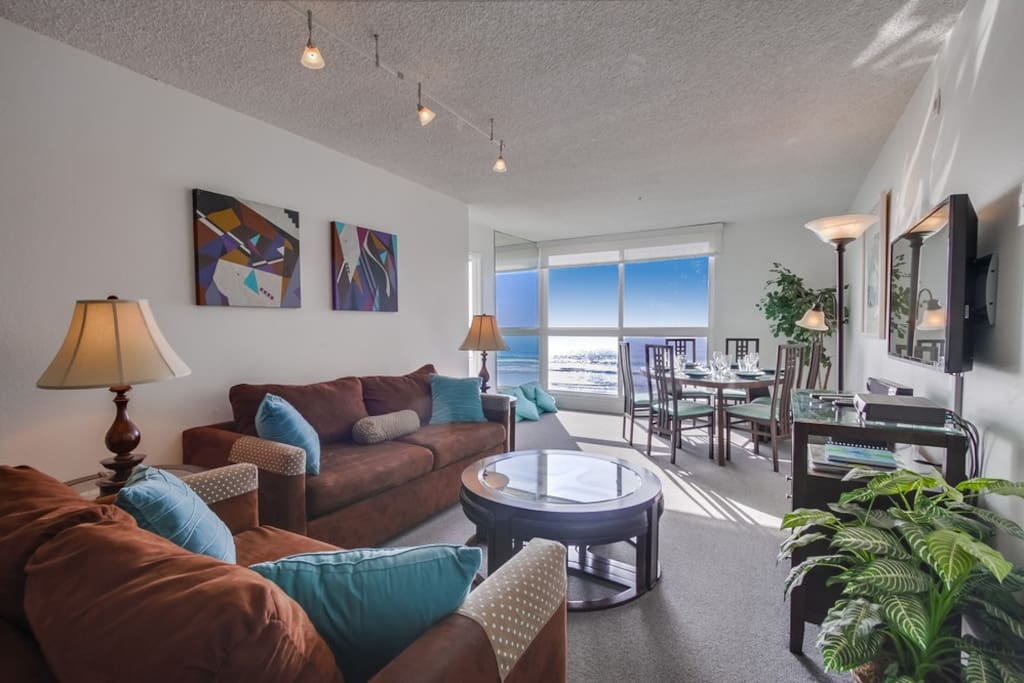 Ocean views from every room Large flat screen TV with cable in living room.