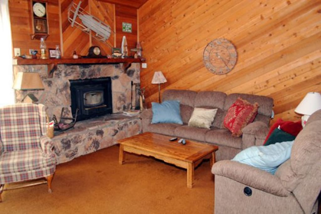 Mammoth Condo Rental Snowflower 13 - Living Room has a Fireplace and Outside Deck