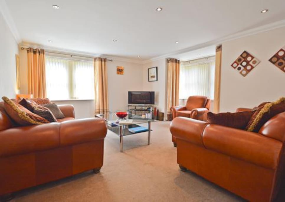 """Living room furnished in a contemporary style with 43"""" Flat LED TV, DVD and CD radio."""