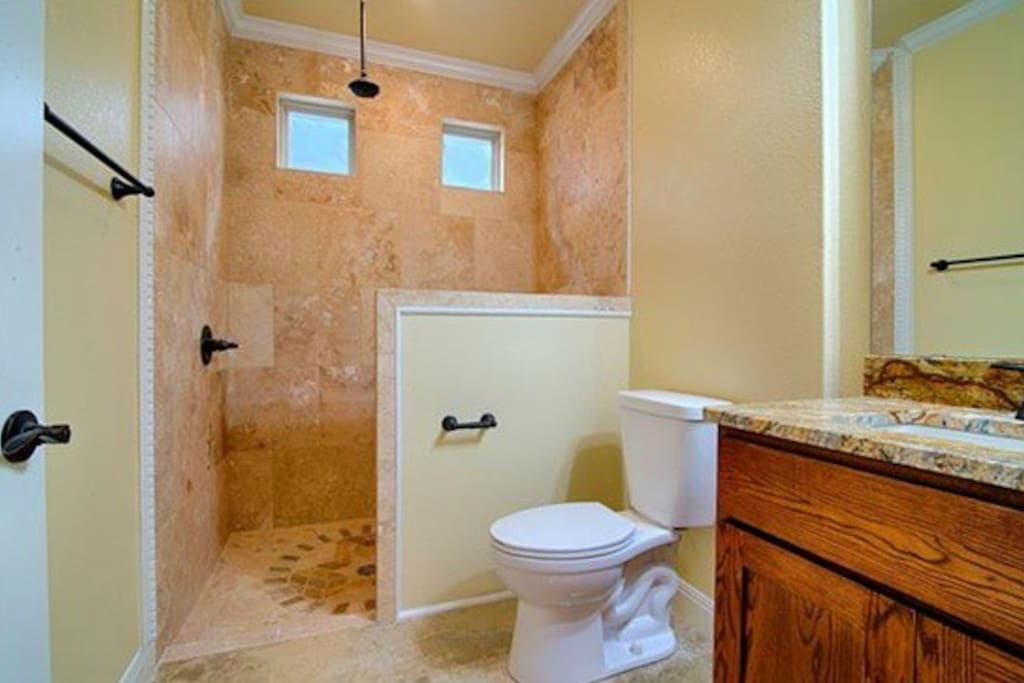 Bathroom includes L'Occittan toiletries and clean towels.