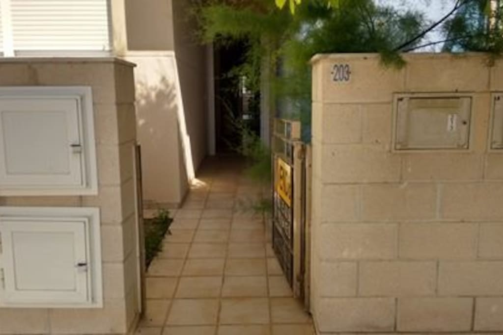 entrance with parking space in front of apartment