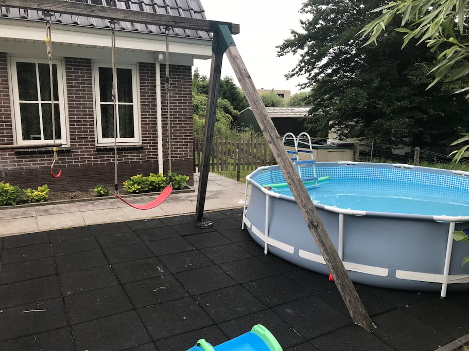 The swimming pool and swings
