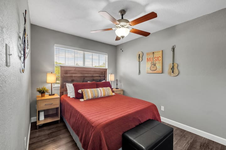 The country chic second bedroom will have you waking up rested with a super comfortable queen bed