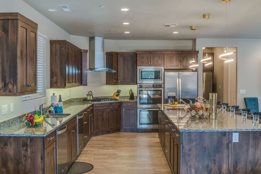 Deluxe kitchen with 2 dishwashers, sinks, refrigerators, and a double wall oven