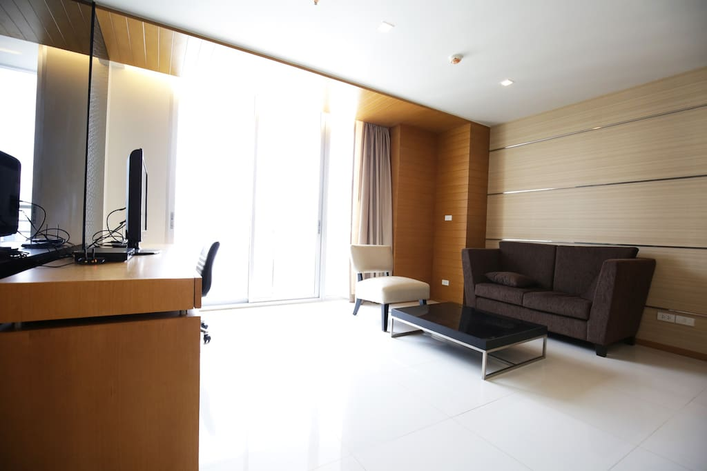 Spacious living area with LED TV