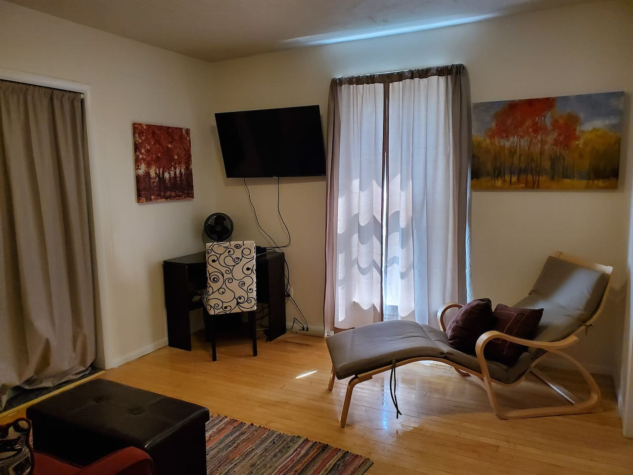 Comfortable living space with TV, WiFi, and working desk.  South facing window with view of the South Hills - easy access to biking and hiking trails.