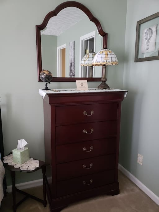 A spacious dresser, with five drawers for your personal belongings.