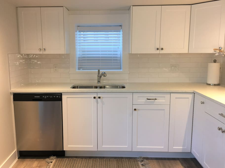 KITCHEN: Dishwasher, 8 place setting dish set including plates, salad plates, bowls, and cups, cutlery. 16 drinking glasses. We provide dish soap, dishwasher cubes, dishtowels and dishcloths. Please note: WE RECYCLE