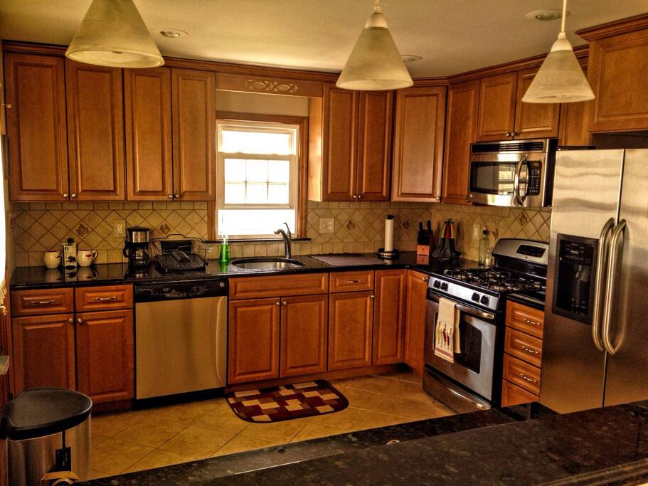 Lovely kitchen with granite counter tops and all stainless steel appliances.