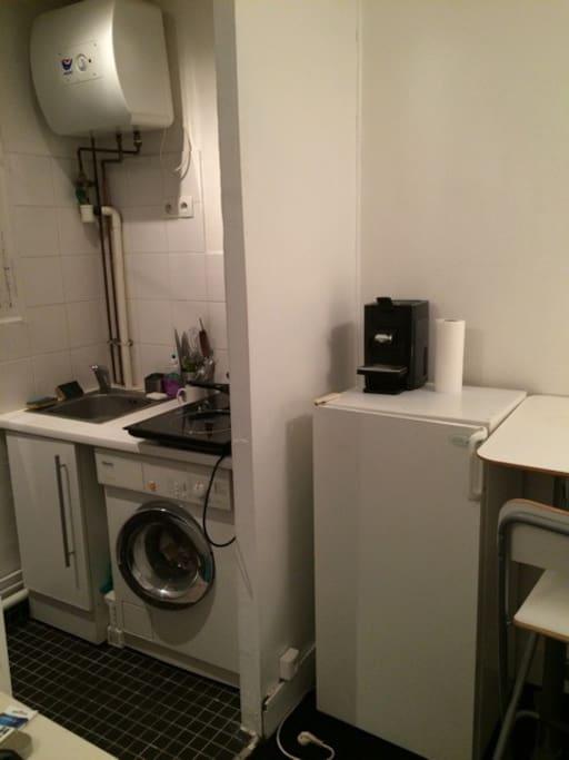 Washing machine, equiped kitchen, desk and coffee machine