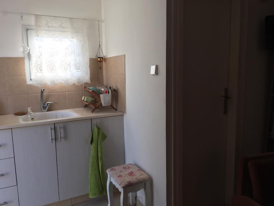 small kitchen next to the shower