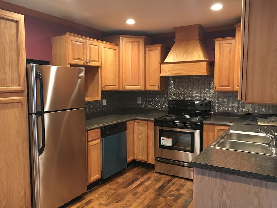This is the kitchen with brand new, stainless steel appliances available for your culinary expertise.