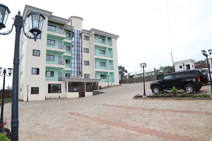 Hello  Welcome to ADMIRALTY SERVICED APARTMENTS. The Place to stay while in BAMENDA, Cameroon. We offer furnished apartments of high quality and are Mordern. These are a compelling hotel alternative for travellers. In contrast to hotel rooms, Admiralty Serviced Apartments offers more space, independence and flexibility. Our apartments are family-friendly and ideal for small groups as they deliver an unbeatable cost per person up to 4 persons per apartment. They are self cartering or with Maids on demand. They are the unique family alternatives to a hotel, featuring spacious studios, one and two bedroom apartments with Queen size beds, bathrooms & en-suits, elegantly designed living rooms, and fully equipped kitchens, microwaves, fridges and ovens. Included also are linens, bathrobes, dishes, phones, utilities, cable TV, balcony daily house keeping  service. A spacious family home away from home. Living room for entertainment or work. If you feel like cooking a fully equipped kitchen to  Carter  for your family needs.
