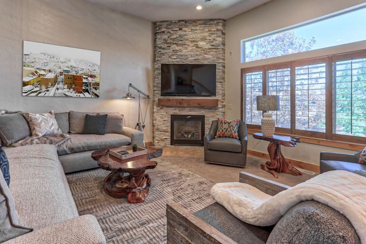 """Beautiful and Comfortable Living Room with 65"""" 4K Smart TV, Gas Fireplace and Windows for Natural Light"""