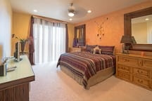 Master bedroom w/access to patio