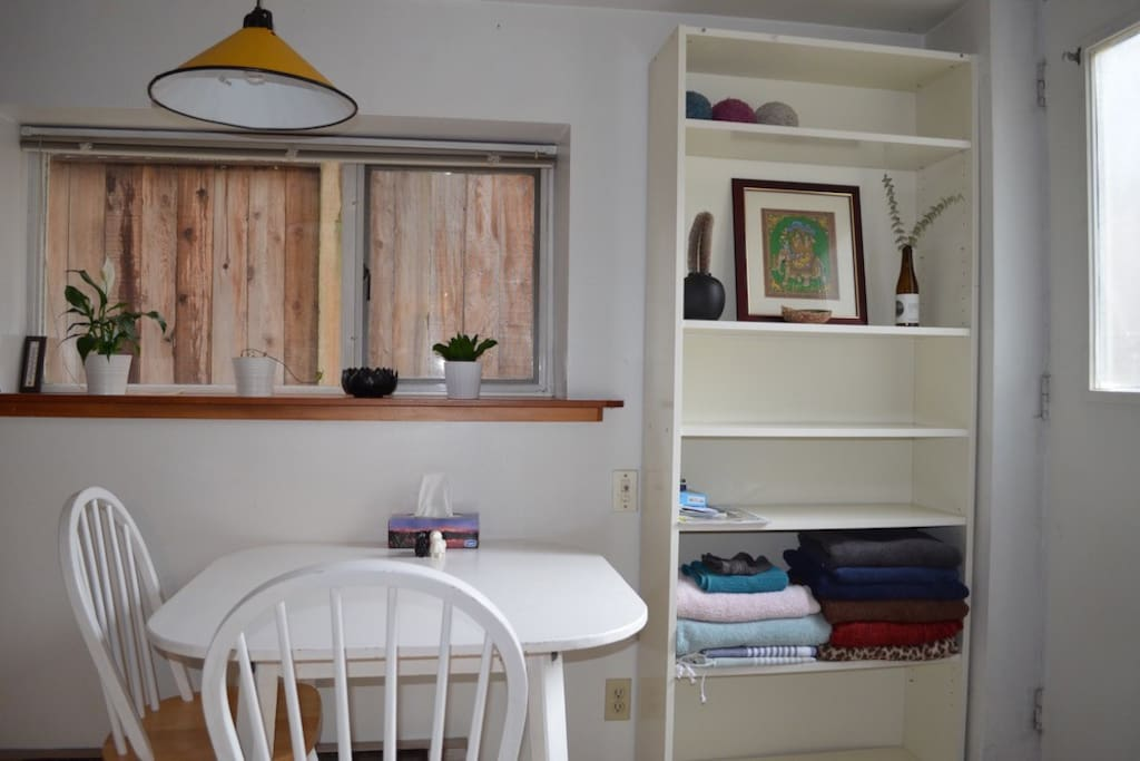 Kitchen table and shelf space for the guests