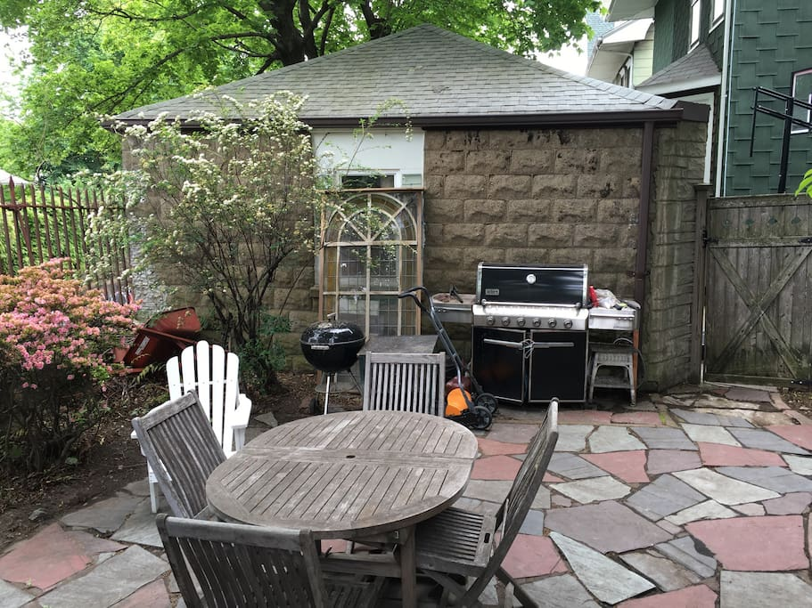 Backyard patio with grill.