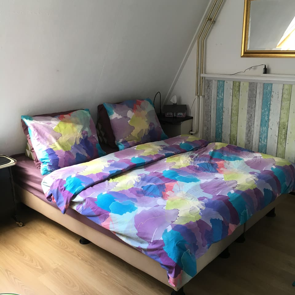 Double bed, can also be made up with single duvets