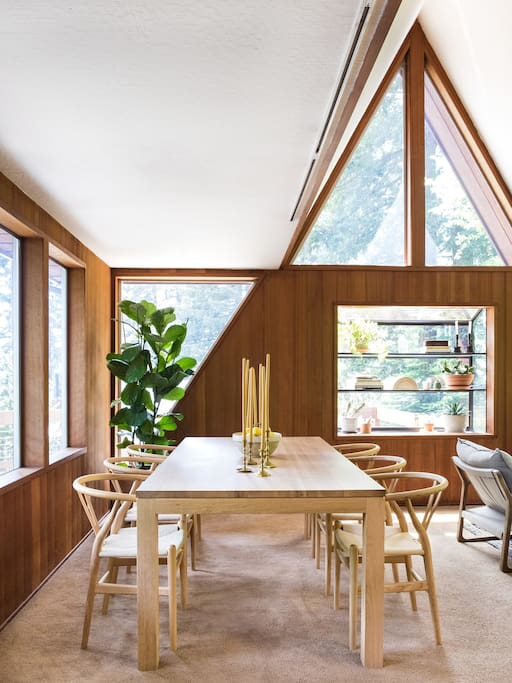 The dining area overlooks redwood trees.