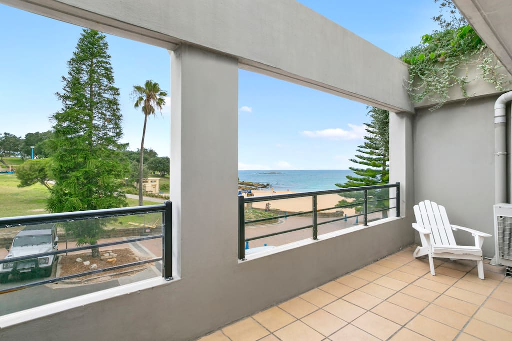 Large balcony with sweeping beach and park views