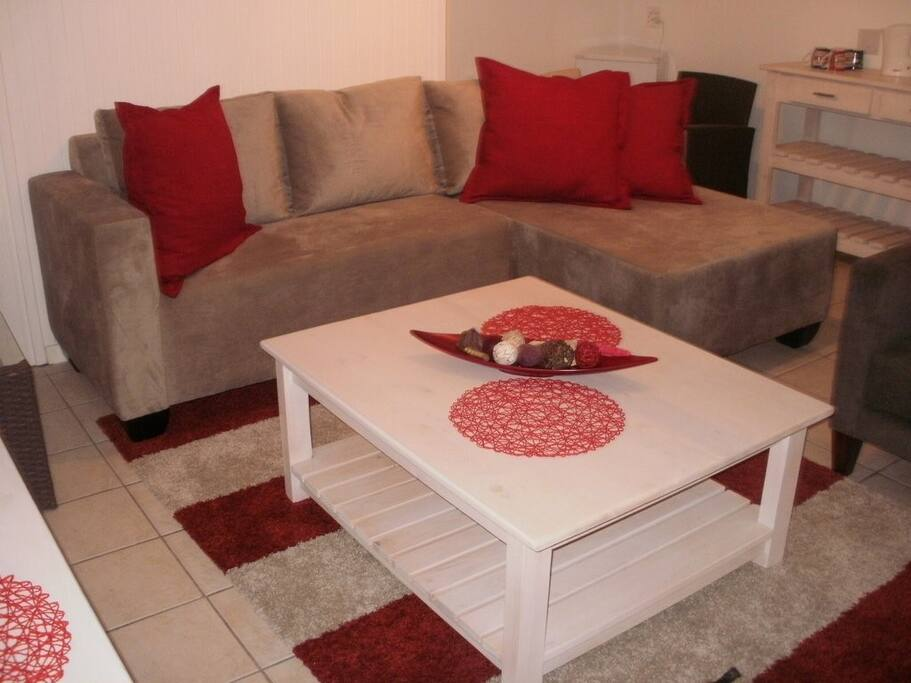 Second lounge situated downstairs with two bedrooms leading onto covered terrace overlooking the dam